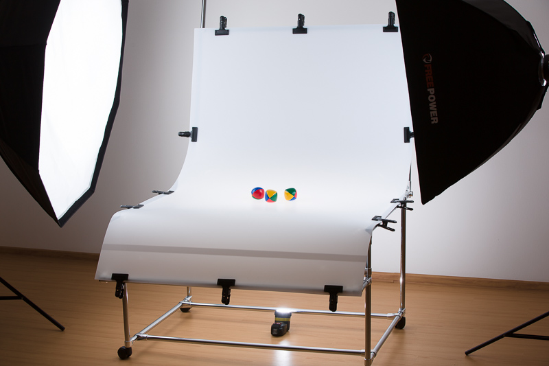 A scene with a shooting table with three lights.